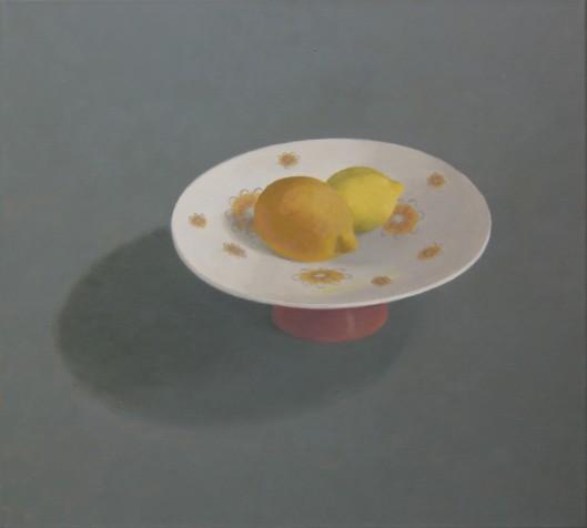 twee citroenen op schaal